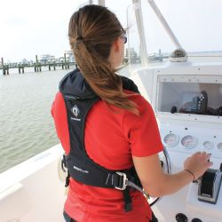Back view of Woman Wearing Crewsaver ErgoFit 40 Pro USCG Automatic Inflatable PFD - with Harness